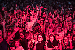© Licensed to London News Pictures . 09/09/2017. Manchester , UK . Crowd dancing . We Are Manchester reopening charity concert at the Manchester Arena with performances by Manchester artists including  Noel Gallagher , Courteeners , Blossoms and the poet Tony Walsh . The Arena has been closed since 22nd May 2017 , after Salman Abedi's terrorist attack at an Ariana Grande concert killed 22 and injured 250 . Money raised will go towards the victims of the bombing . Photo credit: Joel Goodman/LNP