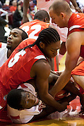 Boston University center, Patrick Hazel, struggles for possesion with Stony Brook University players during first half action at Agganis Arean in Boston, Massachusetts.