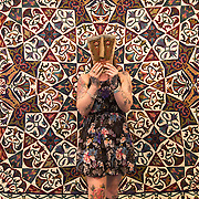 Tracey Alexander from Paisley holds a Peruvian funerary mask as stands beside an Egyptian tent wall called The Lotus Garden made in Cairo by tentmaker Tarok Fattoh in his shop on the 14th century street Chareh El-Khiamiah. The exhibits include Amazonian textiles and elephant covers from India are part of Sandra Hardy's collection which is on display at Hobbycrafts in the SEC, Glasgow  from 2-5th March. Picture Robert Perry  2nd March 2017<br /> <br /> Must credit photo to Robert Perry<br /> FEE PAYABLE FOR REPRO USE<br /> FEE PAYABLE FOR ALL INTERNET USE<br /> www.robertperry.co.uk<br /> NB -This image is not to be distributed without the prior consent of the copyright holder.<br /> in using this image you agree to abide by terms and conditions as stated in this caption.<br /> All monies payable to Robert Perry<br /> <br /> (PLEASE DO NOT REMOVE THIS CAPTION)<br /> This image is intended for Editorial use (e.g. news). Any commercial or promotional use requires additional clearance. <br /> Copyright 2014 All rights protected.<br /> first use only<br /> contact details<br /> Robert Perry     <br /> 07702 631 477<br /> robertperryphotos@gmail.com<br /> no internet usage without prior consent.         <br /> Robert Perry reserves the right to pursue unauthorised use of this image . If you violate my intellectual property you may be liable for  damages, loss of income, and profits you derive from the use of this image.