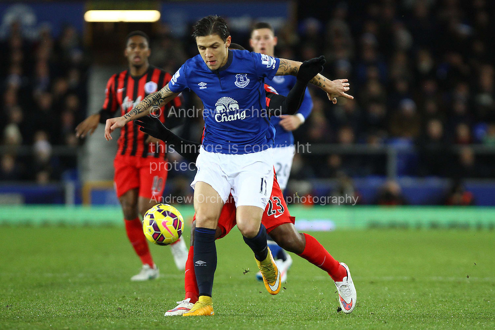 Muhamed Besic of Everton gets in front of David Hoilett of Queens Park Rangers. Barclays Premier league match, Everton v Queens Park Rangers at Goodison Park in Liverpool, Merseyside on Monday 15th December 2014.<br /> pic by Chris Stading, Andrew Orchard sports photography.