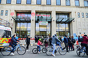 Cyclists ride past the Shell oil HQ on 15th April 2019 in London, United Kingdom.  Extinction Rebellion a climate change protest group are protesting  across the centre of London and plan to block traffic for the next five days.