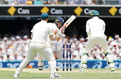 England's Chris Woakes is bowled by Nathan Lyon during day two of the Ashes Test match at The Gabba, Brisbane.