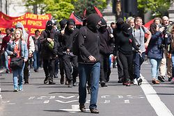 London, May 1st 2015. Hundreds of workers and Trade Unionists from across the UK are joined by Turks, Kurds and anti-capitalists as they march through London on May Day. PICTURED: Masked and black-clad, anti-capitalists surge ahead of the organised march.