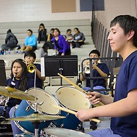 012114  Adron Gardner/Independent<br /> <br /> Zuni High School band drummer Ethan Yatsattie, sets the beat during a basketball game time out in Zuni Tuesday.
