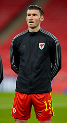 LONDON, ENGLAND - Thursday, October 8, 2020: Wales' Kieffer Moore lines-up for the national anthem before the International Friendly match between England and Wales at Wembley Stadium. The game was played behind closed doors due to the UK Government's social distancing laws prohibiting supporters from attending events inside stadiums as a result of the Coronavirus Pandemic. England won 3-0. (Pic by David Rawcliffe/Propaganda)