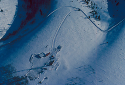 Aerial view of a snow covered oil and gas work site in Wyoming.