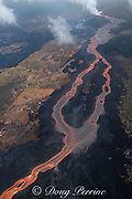 Aerial view of Kilauea Volcano east rift zone erupting hot lava from Fissure 8 in the Leilani Estates subdivision near the town of Pahoa. The lava drains downhill as an incandescent river to Kapoho, Puna District, Hawaii Island ( the Big Island ), Hawaiian Islands, U.S.A.