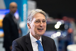 © Licensed to London News Pictures . 02/10/2017. Manchester, UK. Chancellor PHILIP HAMMOND being interviewed by Robert Peston , at the start of the second day of the Conservative Party Conference at the Manchester Central Convention Centre . Photo credit: Joel Goodman/LNP