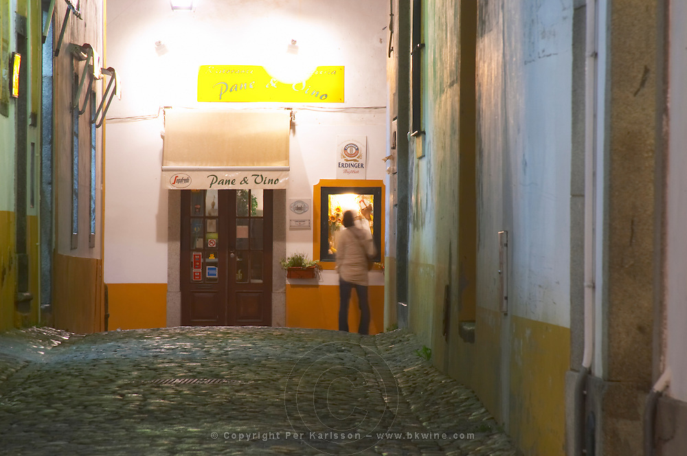 Street view. Cobble stones. Restaurant. Evora, Alentejo, Portugal