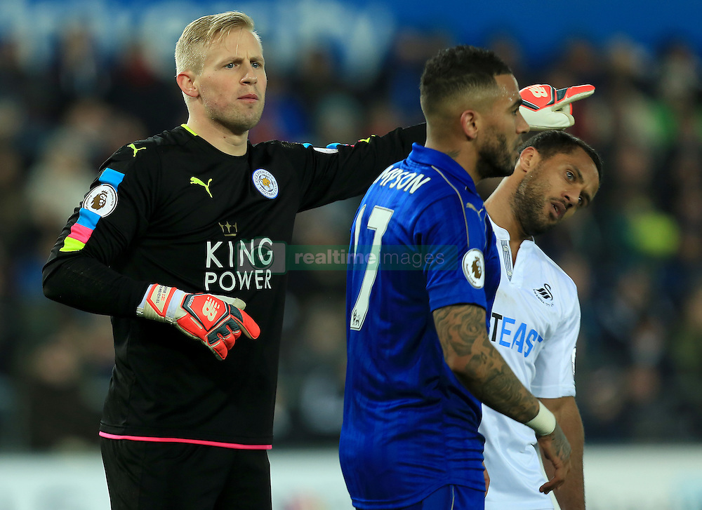 12 February 2017 - Premier League - Swansea City v Leicester City - Wayne Routledge of Swansea City ducks under the arm of Kasper Schmeichel of Leicester City as he points directions - Photo: Paul Roberts / Offside