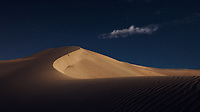 Under the moonlight, I had these beautiful moments with Dunes of the Mecca Region of Saudi Arabia last night. I decided to take it after I attracted by the beautiful contrast between the color of the sky and the color of golden sand.