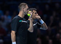 Tennis - 2019 Nitto ATP Finals at The O2 - Day One<br /> <br /> Doubles Group Jonas Bjorkman: Lukasz Kubot (POL) & Marcelo Melo (BRA) Vs. Ivan Dodig (CRO) & Filip Polasek (SVK)<br /> <br /> Filip Polasek (SLO) and Ivan Dodig (BOS) confer on play at the O2 Arena <br /> <br /> COLORSPORT/DANIEL BEARHAM