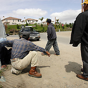 SAN DIEGO, CA, MAY 4, 2007:  Day laborers gather in hopes of finding temporary work in San Diego, California on May 4, 2007. The migrant workers, mostly from Mexico, stand on street corners and in deserted lots where contractors and homeowners come looking for cheap labor. Trucks pull up and ask for workers. (Photo by Todd Bigelow/Aurora) Please contact Todd Bigelow directly with your licensing requests.