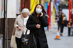 © Licensed to London News Pictures. 05/02/2020. London, UK. An Asian woman in Chinatown wearing a face mask following the outbreak of Coronavirus in Wuhan, China. At least 427 people have died from the virus and there have been over 20,000 confirmed cases, most of them in China. Photo credit: Dinendra Haria/LNP