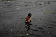 A boy swims in the heavily polluted Buriganga river in the capital Dhaka, Bangladesh, April 26, 2019. As we keep on unleashing harmful chemicals into the environment our children face the harrowing prospect of becoming the innocent victims of a threat they did not create, nor wished for.