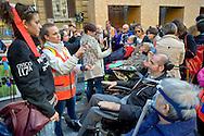 Roma 4 Novembre  2014.<br /> Manifestazione davanti al ministero dell'Economia del Comitato 16 Novembre, associazione di persone malate di Sla e loro famigliari, per chiedere il ripristino del fondo della non autosufficienza  ridotto a 250 milioni con la legge di Stabilità, non solo torni a 350 milioni ma venga aumentato a un miliardo. Un infermiera comunica con un ammalato di Sla con la Tavola di Comunicazione.<br /> Rome November 4, 2014. <br /> Demonstration in front of the Ministry of Economy Committee November 16, an association of people sick  with ALS and their families, to ask for the restoration fund of self-sufficiency reduced to 250 million by the law of stability, not only back to 350 million but is increased one billion. A nurse  communicates with a patient with ALS with the Table of Communication