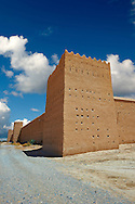 Outer wall fortifications of the  Alaouite Ksar Fida built by Moulay Ismaïl the second ruler of the Moroccan Alaouite dynasty ( reigned 1672–1727 ). Residence of the Khalifa or Caid of Tafilalet until 1965. Tafilalet Oasis, near Rissini, Morocco .<br /> <br /> Visit our MOROCCO HISTORIC PLAXES PHOTO COLLECTIONS for more   photos  to download or buy as prints https://funkystock.photoshelter.com/gallery-collection/Morocco-Pictures-Photos-and-Images/C0000ds6t1_cvhPo<br /> .<br /> <br /> Visit our ISLAMIC HISTORICAL PLACES PHOTO COLLECTIONS for more photos to download or buy as wall art prints https://funkystock.photoshelter.com/gallery-collection/Islam-Islamic-Historic-Places-Architecture-Pictures-Images-of/C0000n7SGOHt9XWI