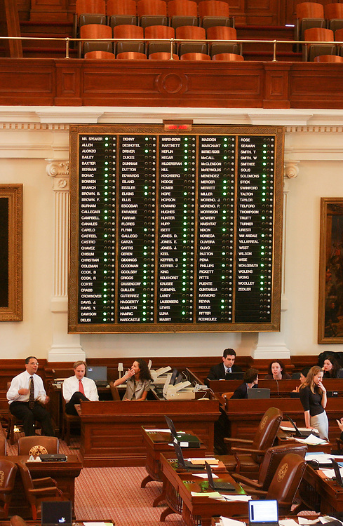Images from 2003's Democratic walkout in the Texas House from May 12-13, 2003 during the 78th session of the Texas Legislature include the voting board with missing Democrats.