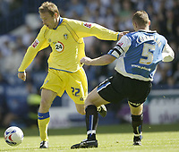 Photo: Aidan Ellis.<br /> Sheffield Wednesday v Leeds United. Coca Cola Championship. 27/08/2006.<br /> Leeds ian Moore (L) takes on Wednesday's Graham Coughlan