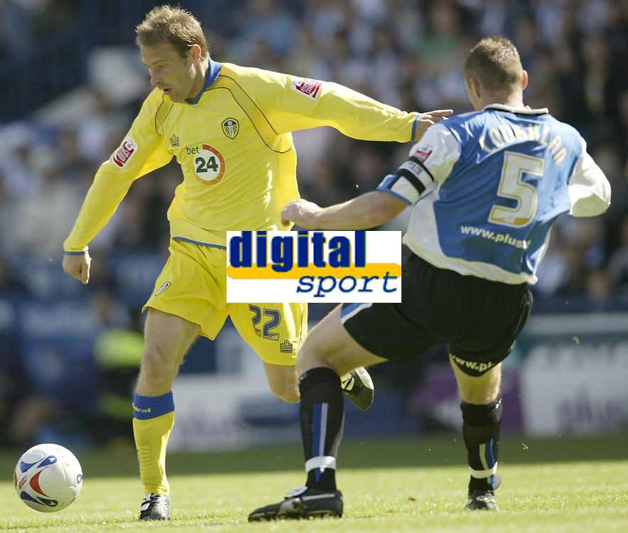 Photo: Aidan Ellis.<br /> Sheffield Wednesday v Leeds United. Coca Cola Championship. 27/08/2006.<br /> Leeds ian Moore (L) takes on Wednesday's Graham Coughlan