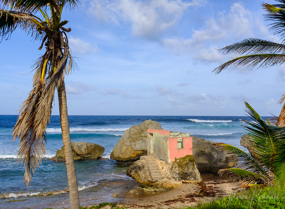 View of a crumbling pink building on an outcropping of rocks on the Northern shore of Barbados