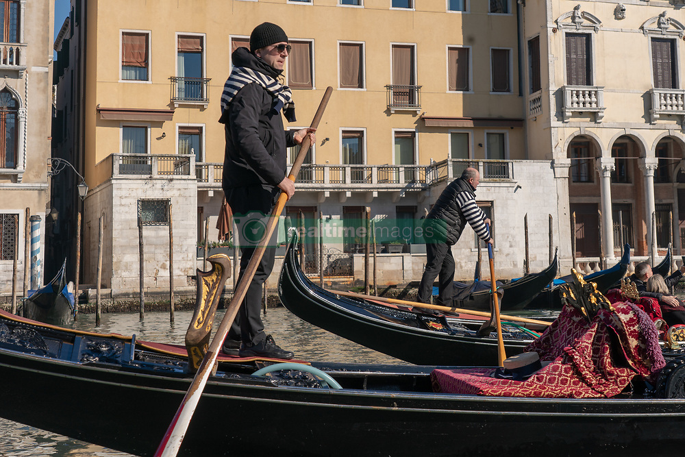 A view of various gondoliers on a canal in Venice. From a series of travel photos in Italy. Photo date: Sunday, February 10, 2019. Photo credit should read: Richard Gray/EMPICS