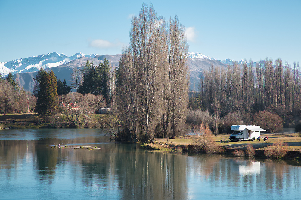 Campervan parked beside the Albert Town campground which is a great spot beside the Clutha<br /> and Hawea Rivers, Wanaka, South Island, NZ