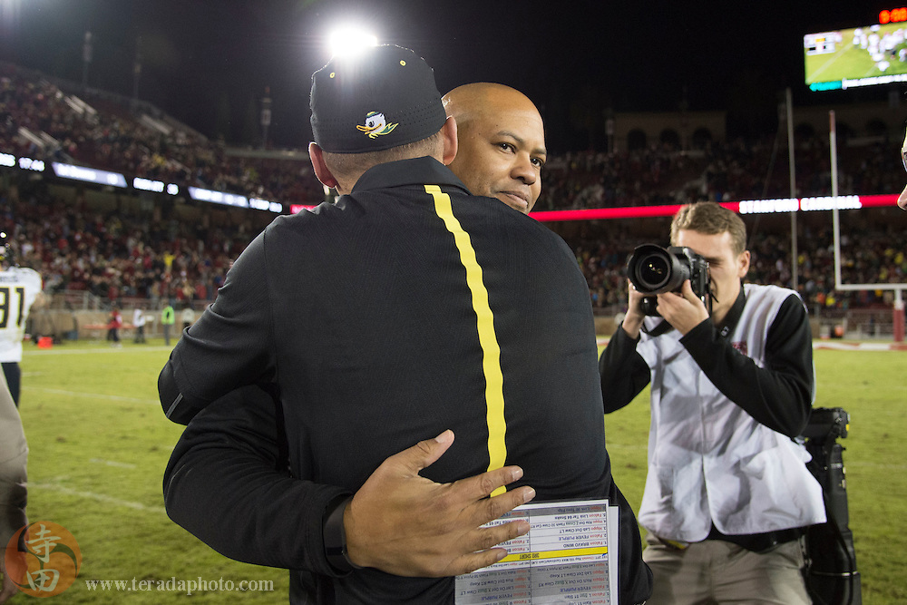 November 14, 2015; Stanford, CA, USA; Stanford Cardinal head coach David Shaw hugs Oregon Ducks head coach Mark Helfrich after the game at Stanford Stadium. The Ducks defeated the Cardinal 38-36.