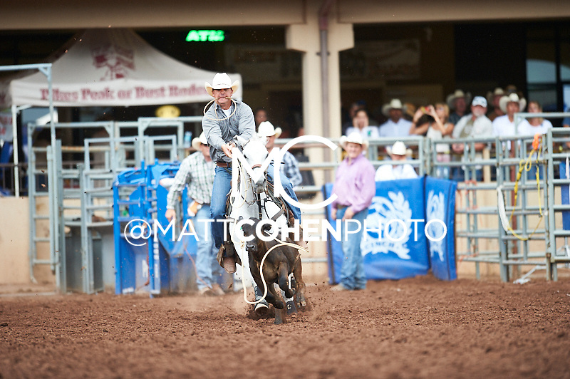 Tie-down roper Stewart Gulager of Fort Scott, KS competes at the Pikes Peak or Bust Rodeo in Colorado Springs, CO.<br /> <br /> <br /> UNEDITED LOW-RES PREVIEW<br /> <br /> <br /> File shown may be an unedited low resolution version used as a proof only. All prints are 100% guaranteed for quality. Sizes 8x10+ come with a version for personal social media. I am currently not selling downloads for commercial/brand use.