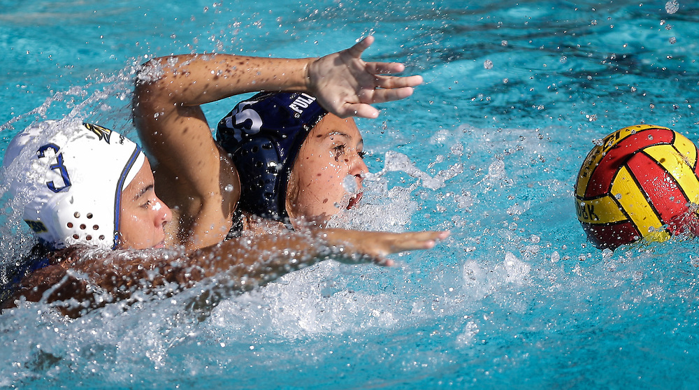 the Cypress College Chargers sophomore (3) Jeniffer Iniguez (left) and The Fullerton Colege Buzzys  sophmore (15) Marissa Vaccher (right) battle for position of the ball. Fullerton College would beat the Cypress College Chargers 17-3 on October 33rd 2016 in Mission Viejo Calif.. Photo By: Daniel Bowyer/Sports Shooter Academy