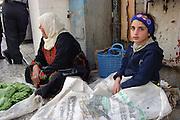 Mother and daughter selling vegetables Old Jerusalem Israel