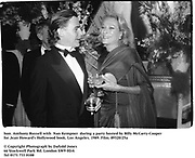 hon. Anthony Russell with  Nan Kempner  during a party hosted by Billy McCarty-Cooper for Jean Howard's Hollywood book. Los Angeles. 1989. Film.89320/25a<br /><br />© Copyright Photograph by Dafydd Jones<br />66 Stockwell Park Rd. London SW9 0DA<br />Tel 0171 733 0108