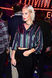 Poppy Delevingne during the Tommy Hilfiger Front row during London Fashion Week SS18 held at Roundhouse, Chalk Farm Rd, London. Picture Date: Tuesday 19 September. Photo credit should read: Ian West/PA Wire