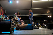 WASHINGTON, USA - August 19: A boy lays on the stage after falling out of his chair while hypnotized during a comedy show at the Montgomery County Agricultural Fair in Gaithersburg, Md., USA on August 19, 2017.