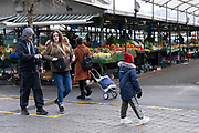 National coronavirus lockdown three begins in Birmingham city centre, which is deserted apart from a few people many of whom are not wearing face masks, come to a very quiet open fruit and veg market on 6th January 2021 in Birmingham, United Kingdom. Following the recent surge in cases including the new variant of Covid-19, this nationwide lockdown, which is an effective Tier Five, came into operation today, with all citizens to follow the message to stay at home, protect the NHS and save lives.