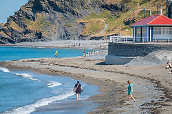 © Licensed to London News Pictures<br /> 02 July 2018 . Aberystwyth Wales UK<br /> <br /> UK Weather:  People head to the seaside in Aberystwyth as the scorchingly hot  and very dry weather continues to dominate the UK.<br /> After a brief respite overnight, with some light rain, the searing heat has returned , with temperatures  again rising to the low 30º's this week<br /> <br /> photo credit Keith Morris / LNP