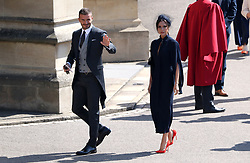 David and Victoria Beckham arrive for the wedding of Prince Harry and Meghan Markle at Windsor Castle.