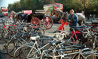 St Stephen's Green, Dublin, Ireland, Jarveys wait for clients. Bicycle park. 199710004.<br /> <br /> Copyright Image from Victor Patterson, Belfast, UK<br /> <br /> t: +44 28 9066 1296 (from Rep of Ireland 048 9066 1296)<br /> m: +44 7802 353836<br /> e: victorpattersonbelfast@gmail.com<br /> <br /> www.images4media.com<br /> <br /> Please see my full Terms and Conditions of Use at https://www.images4media.com/p/terms-conditions - it is IMPORTANT that you familiarise yourself with them.<br /> <br /> Images used online incur an additional cost. This cost should be agreed in writing in advance. Online images must be visibly watermarked i.e. © Victor Patterson or that of the named photographer within the body of the image. The original metadata must not be deleted from images used online.<br /> <br /> This image is only available for the use of the download recipient i.e. television station, newspaper, magazine, book publisher, etc, and must not be passed on to a third party. It is also downloaded on condition that each and every usage is notified within 7 days to victorpattersonbelfast@gmail.com.<br /> <br /> The right of Victor Patterson (or the named photographer) to be identified as the author is asserted in accordance with The Copyright Designs And Patents Act (1988). All moral rights are asserted.