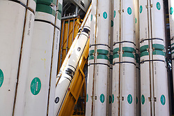 Stock photo of distributor riser buoyancy modules stacked on a deepwater offshore drilling rig