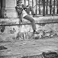 A street performer in Havana, Cuba plays some blues.
