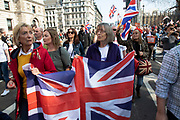 Thousands of Leave supporters gathered in Parliament Square to protest against the delay to Brexit, on the day the UK had been due to leave the EU on 29th March 2019 in London, United Kingdom. As parliament debated and voted inside the commons, rejecting the Withdrawal Agreement again, outside in Westminster various groups of demonstrators including the Yellow Jackets, Leave Means Leave supporters and the Democratic Football Lads Alliance, gathered to voice their wish to leave the European Union, and their frustration that Brexit is not being delivered, waving Union flags and Believe in Britain placards.