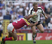 © Intersport Images .Photo Peter Spurrier.12/05/2002.Sport - Rugby League.London Broncos vs Widnes Vikings.Dan Potter tackled by Broncos, Steele Retchless....