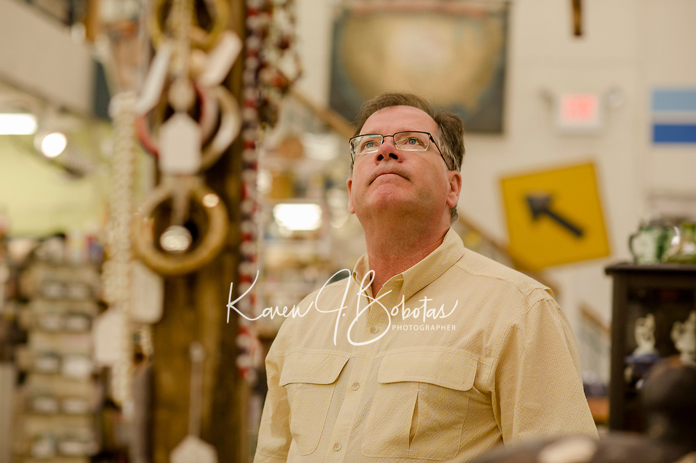 Roland Nutter of Pepperell, MA browses through the aisles at Laconia Antique Center on downtown Main Street.  (Karen Bobotas/for the Laconia Daily Sun)