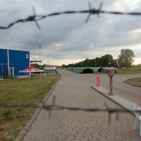 Refugee camp seen through barbed wire fence near border town Roszke (about 180 km South-East of capital city Budapest), Hungary on July 16, 2015. ATTILA VOLGYI
