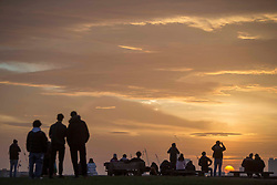 © Licensed to London News Pictures.20/02/2021. London, UK. Members of the public enjoying sunrise on Primrose Hill in North London. The weather forecasts predict that it will be the warmest weekend since November.  Photo credit: Marcin Nowak/LNP