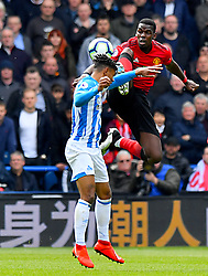 Huddersfield Town's Juninho Bacuna (left) and Manchester United's Paul Pogba battle for the ball during the Premier League match at the John Smith's Stadium, Huddersfield.