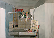 a wash basin with brushes, pots and paint spots, in a painter laboratory