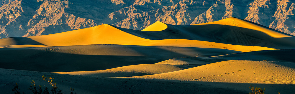 Late afternoon light accentuates the ripples and patterns of light and shadow on Mesquite Flat sand dunes in Death Valley National Park