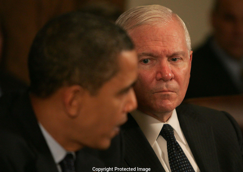 Secretary of Defense watches President Barack Obama speaks at a cabinet meeting on November 23rd 2009 in Washington, DC.    photo by Dennis Brack
