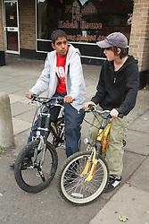 Boys on bikes hanging round precinct.